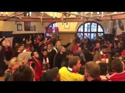 Arsenal fans take over a pub in Munich before game against Bayern Munich